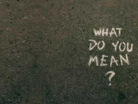 "Ground with sentence ""what do you mean"" written on it"